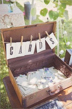 We love this vintage suitcase used to display vintage letters. Why not create your own vintage postcards and allow guests to write a message to put in it in lieu of a guestbook! #vintagerusticwedding