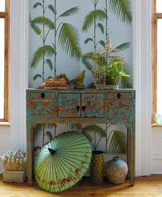 Great wallpaper for the end of a hallway, interesting use of different styles and cultures here, notice the use of similar tones...clever!