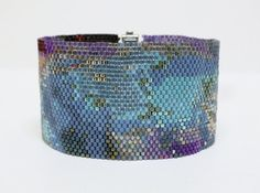 Title: Summer Storm  OOAK (one of a kind) beadwoven cuff bracelet. This is a peyote beadwoven designed by me containing 56 different colors of