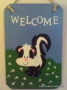 Skunk Welcome Sign http://elsieonthelake62.blogspot.com/