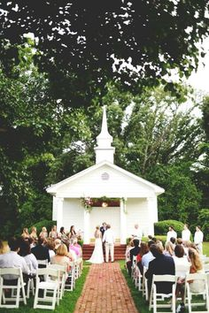 Beautiful wedding in front of our little white Chapel.   Roseland Wedding Chapel & Ballroom  903/849-5553 Photography: Stephanie Parsley