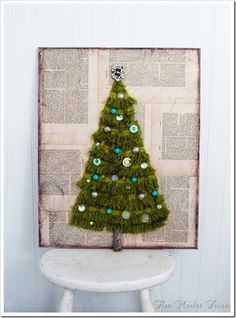 super cute fringe christmas tree on artists canvas with vintage buttons and broach for tree topper. Cute blog!