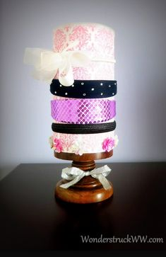 Step by step instructions on how to create a DIY Headband Organizer using an oatmeal canister. You can also store barrettes, bows and hair clips inside the canister! How cool is that?