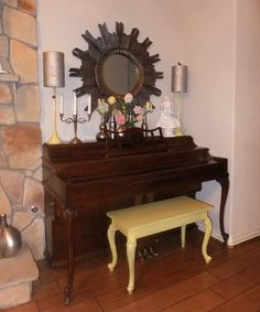 Add a splash of color to your piano by painting the bench in accent color. You can also spray paint the lamp base or any accessories that you will put on the top of your piano.