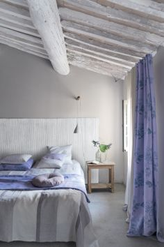Serenity is key in the bedroom and achieved with cool lilacs. Featuring our Hiyoku fabric