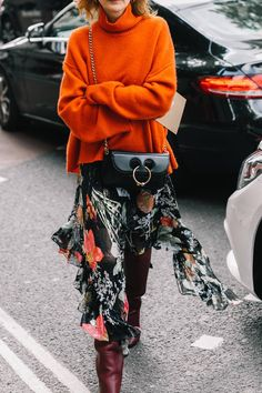 Orange sweater, floral skirt, brown knee high boots