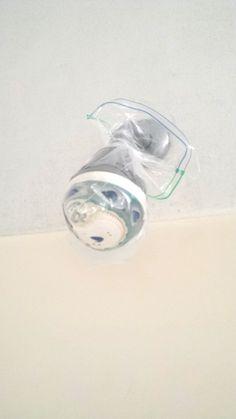 Easy clean shower head or any spray nozzle.  Vinegar, ziplock bag and a twist tie.