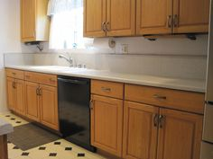 Old formica counter & backsplash.  Still looked okay after 23 years but time to replace!  Not replacing my oak cabinets because I still love them.  I don't care that the trend is to replace or paint white cabinets... Also replaced the linoleum floor with luxury vinyl tile.