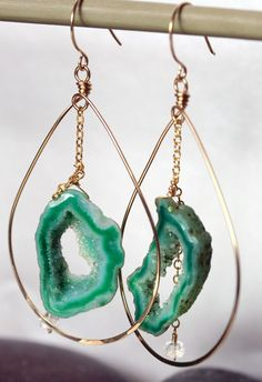 Green Agate Druzy Geode Slice hoop earrings.  Unique and unusual.  Every slice of agate druzy is one of kind.  Each agate slice  has a center cut out with a glistening druse of crystals.The gold hoop earring is handcrafted from 14k gold filled wire and hammered at the bottom for texture and shine.The agate druzy slice hangs from a gorgeous 14k gold filled textured chain.  A AAA moonstone rondelle completes the chain.