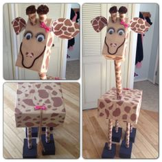 5 foot tall giraffe made out if recycled boxes, wrapping paper tubes, craft wrap & construction paper, yarn & various other art supplies. She took 13 1/2 hours to make, as I cut each spot out by hand. I spent less than $15 on supplies by mainly using or recycling things I had around the house
