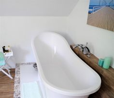 freestanding bathtub, white bathroom,