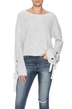 Light grey sweater with long sleeves boat neckline and grommet lace up detailing.  Tie Sleeve Sweater by Mono B. Clothing - Sweaters - Crew & Scoop Neck New York City Manhattan New York City