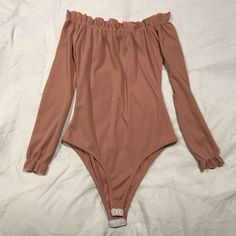 04e18d85e3f8 Nude pink off shoulder bodysuit Worn once and selling due to - Depop