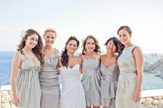 Grey, individually styled bridesmaid dresses...I want to do this but with a different colour!!!
