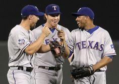 Texas Rangers' Josh Hamilton, center, walks off the field with David Murphy, left, and Nelson Cruz.