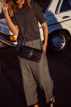 Grey t-shirt and grey pants. Colour block fashion and street style. JW Anderson black and gold bag. Carmen Hamilton on CHRONICLES OF HER. See her editor's blog for more styles.