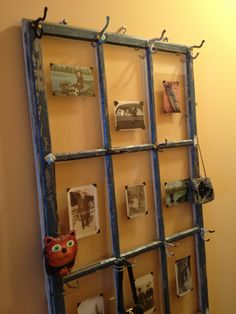 vintage windows or doors with coat hooks, knobs, etc to create your own collage of items