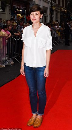 Chic: Emma looked effortlessly cool in her casual outfit, which was set off with a pair of...