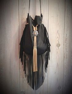 Great little go to cross body bag made from the most beautiful and soft premium cow leather. Comes in Cognac Brown, Camel, Antique White or Black leather. The light Turquoise color is sold out. Contrast drawstring and tassels adorned with a concho. Fringe Crossbody Bag, Fringe Purse, Fringe Bags, Black Crossbody, Leather Fringe, Cow Leather, Leather Craft, Black Leather, Suede Leather