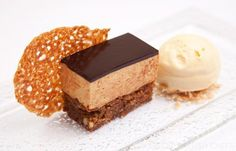 Josh Eggleton serves up a sumptuous hazelnut, caramel and sesame mousse cake, covered in a rich chocolate glaze for an extra special dinner party dessert Dessert Party, Dinner Party Desserts, Cake Recipes, Dessert Recipes, Great British Chefs, Hazelnut Cake, Mousse Cake, Baking Tins, Food Cakes