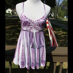 Pretty Top   Pretty white and purple top!! Spaghetti straps,adjustable. Empire bodice then flows down to pleats, half white on one side a purple design on other! A winner!  Mudd Tops