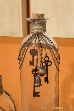 Upcycle glass bottles with twine and jewelry accents for an easy-to-create masterpiece.