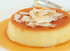 best coconut flan made with coconut milk, coconut extract, and topped with toasted coconut Coconut Flan, Toasted Coconut, Coconut Milk, Mexican Food Recipes, Dessert Recipes, Spanish Recipes, Ethnic Recipes, Panna Cotta, Just Desserts