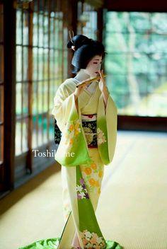 Geiko(Geisha). Kyoto. Japan. She is playing a Japanese bamboo flute.