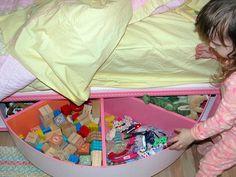 Underbed lazy susan toy storage. Its DIY. nursery-playroom-storage-ideas. This is sooo smart!