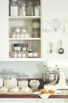 Add hooks to the back of cabinet doors for storage of measuring/baking tools.  Organize This: Baking Supplies!