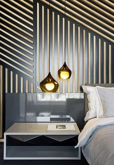 MDF panels cut on a CNC machine offer a dramatic contrasting pattern on a feature wall