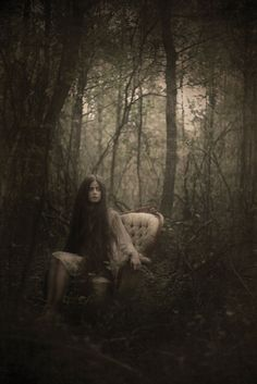 just chillin in her chair in the creepy forrest ;)