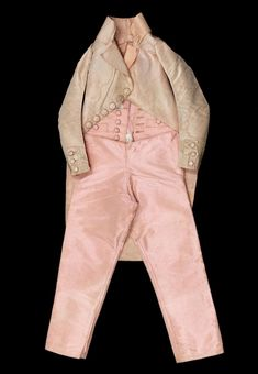 Coat and trousers worn by Louis XVII, Louis Charles de France, Duke of Normandy (1785-1795), c.1792. Pink taffeta, round wooden buttons covered with pink silk thread © Eric Emo / Galliera / Roger-Viollet