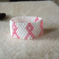 Beadedpeyote stitch breast cancer awareness ring by Mebredesigns