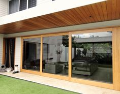 View photos of Timber Sliding Doors by Allkind Joinery. Your Prestige Timber Joinery. Timber Sliding Doors, Timber Door, Stacker Doors, Door Shades, Fabric Awning, Roof Overhang, Exterior Paint Colors, Paint Colours, Pink Houses