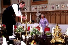 Wow! What a way to set a table. Put on thick socks and set it while walking around on the top. Interesting. Queen Elizabeth watches over.