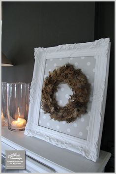 I have an old dried wreath to use and the crisp cool frame and matte makes it look fresh.