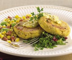 Cornmeal and buttermilk breaded catfish cakes with andouille, corn and fava bean succotash, and curry remoulade, by Arnold Nicholas. Photo by Chris Cassidy.