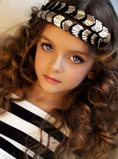 Russian child model Milana Kurnikova. How much more beautiful would she be without all the make-up?