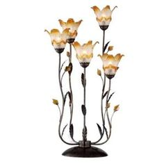 33 in. win dance floral table lamp. Featuring 4 lamps growing out of the base and an antique finish, this table lamp is very distinct. Clear or amber frosted floral glass shades, metal and amber crystal leaves accentuate what is already a beautiful lamp.