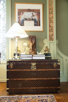 This is definitely traditional but I like it, except for the rug- too brownish and old for me. Also I wouldn't do a green and a peach floral (that's also a bit old), but they get away with it here. Love statues (and busts for that matter), love LV vintage trunk. (Louis Vuitton family home « the selby.)