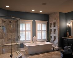 I love the tiled recessed niches on wall at end of the freestanding tub.