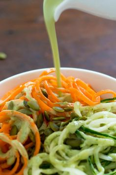 This Carrot and Cucumber Noodles Salad with creamy Avocado Dressing uses spiralized vegetables for a healthier, refreshing pasta salad alternative with fewer carbs.