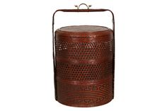 """LARGE CHINESE STACKING BRIDE'S BASKET Item #: 51847 $225.00  Chinese multi-tiered bride's woven basket with brass mounted frame with figural pull. Measurements: 28"""" high and 19"""" wide. Condition: good, consistent with age."""