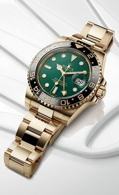 The distinctive face of a Rolex GMT-Master II in yellow gold with a green dial and a black Cerachrom bezel in ceramic. The distinctive face of a Rolex GMT-Master II in yellow gold with a green dial and a black Cerachrom bezel in ceramic. Rolex Watches For Men, Modern Watches, Stylish Watches, Luxury Watches For Men, Vintage Watches, Cool Watches, Rolex Green Face, Rolex Gmt Gold, Black Rolex