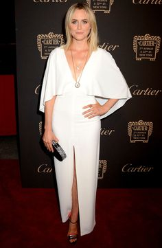 Taylor Schilling in a white flutter sleeve dress