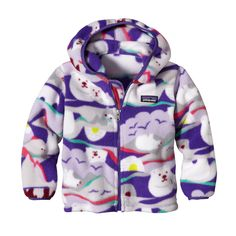 Keep your tiny companion warm and comfortable in the Patagonia Baby Synchilla� Fleece Cardigan. Made of bluesign� approved recycled polyester fleece.