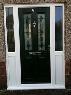 Black composite door in a white upvc frame. Installed by Windseal Double Glazing based in Coventry & Warwickshire Black Composite Front Door, Coventry, Front Doors, Composition, Traditional, Frame, Modern, Entry Doors, Picture Frame