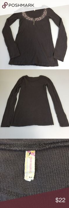 Free People Gray Floral Embroidered Thermal Top, L Free People Gray Floral Embroidered Thermal Top in size Large. Flat lay measure from shoulder to hem is approximately 27. Features a dark gray color with raw edges and floral embroidery in shades of cream and mauve with a bead in the center surrounding the collar. Made from 98% cotton and 2% spandex. In overall very good condition, please look at all photos and ask if you have any questions. Free People Tops Tees - Long Sleeve