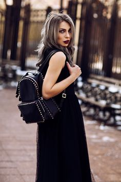 The black Widow | wearing a Valentino backpack and a Valentino dress | New York Fashion Week